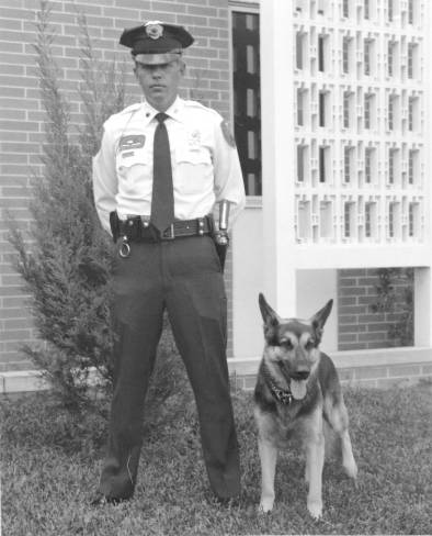 A photo of Officer Ron Bowling Sr. and K9 Sarge