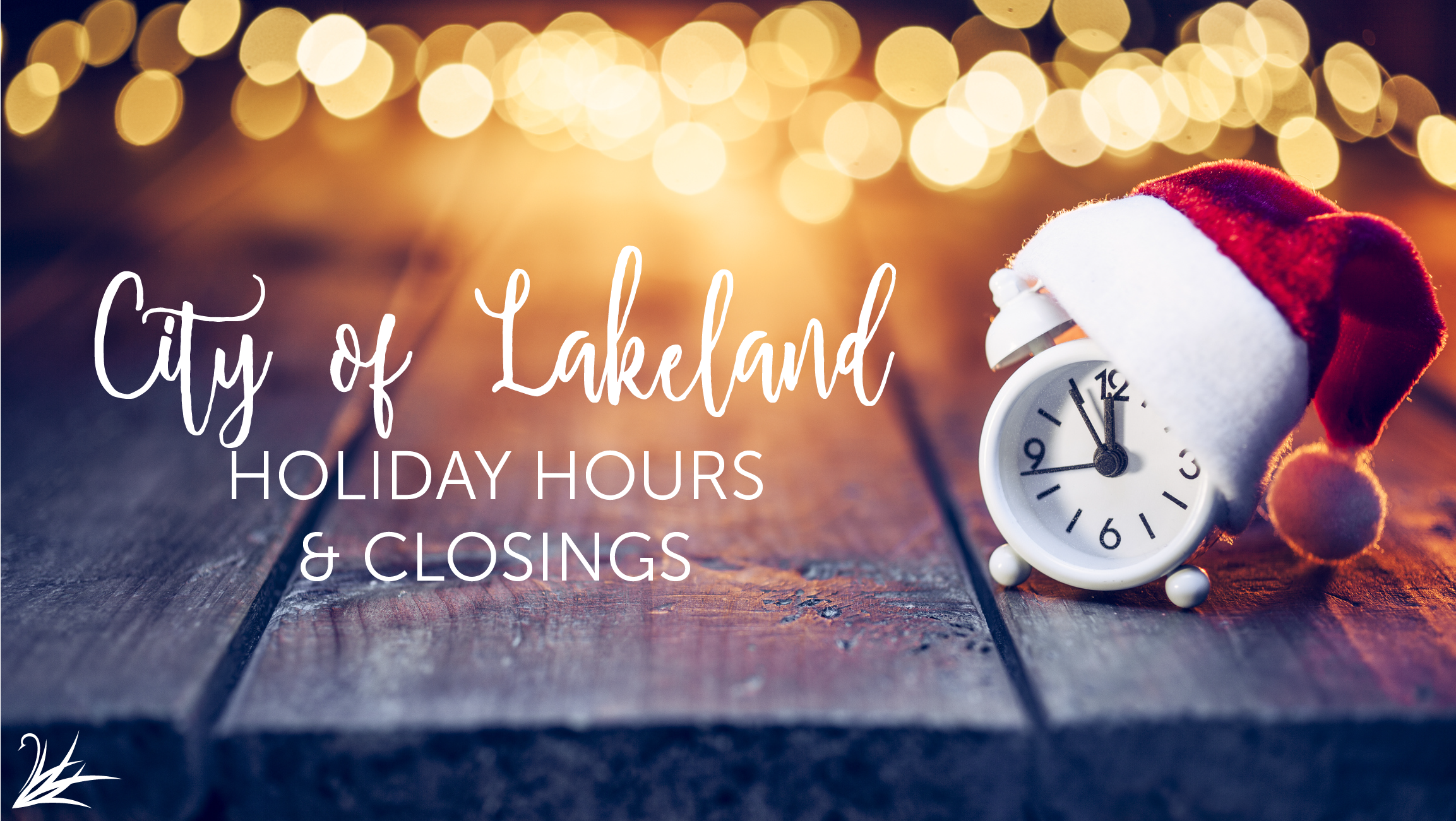 city of lakeland holiday hours photo with clock wearing a santa hat