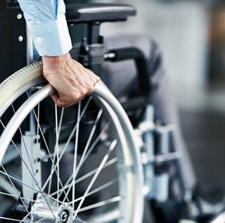 closeup of business man in wheelchair